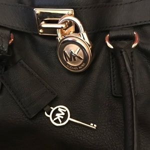 Michael Kors purse with gold chain.
